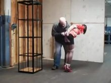Caged in tight bondage