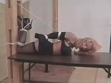 Hogtied and Ball Gagged Blonde on Table