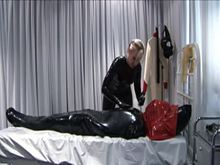 Kat hogtied and ball gagged