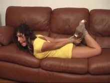 Gagged and tied on sofa