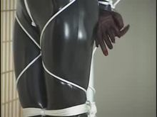 Black catsuit and bondage