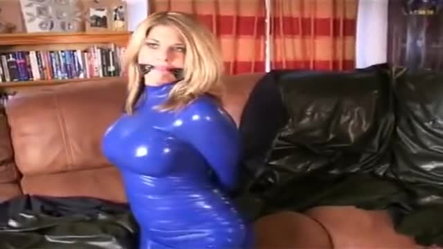 Hogtied in blue latex