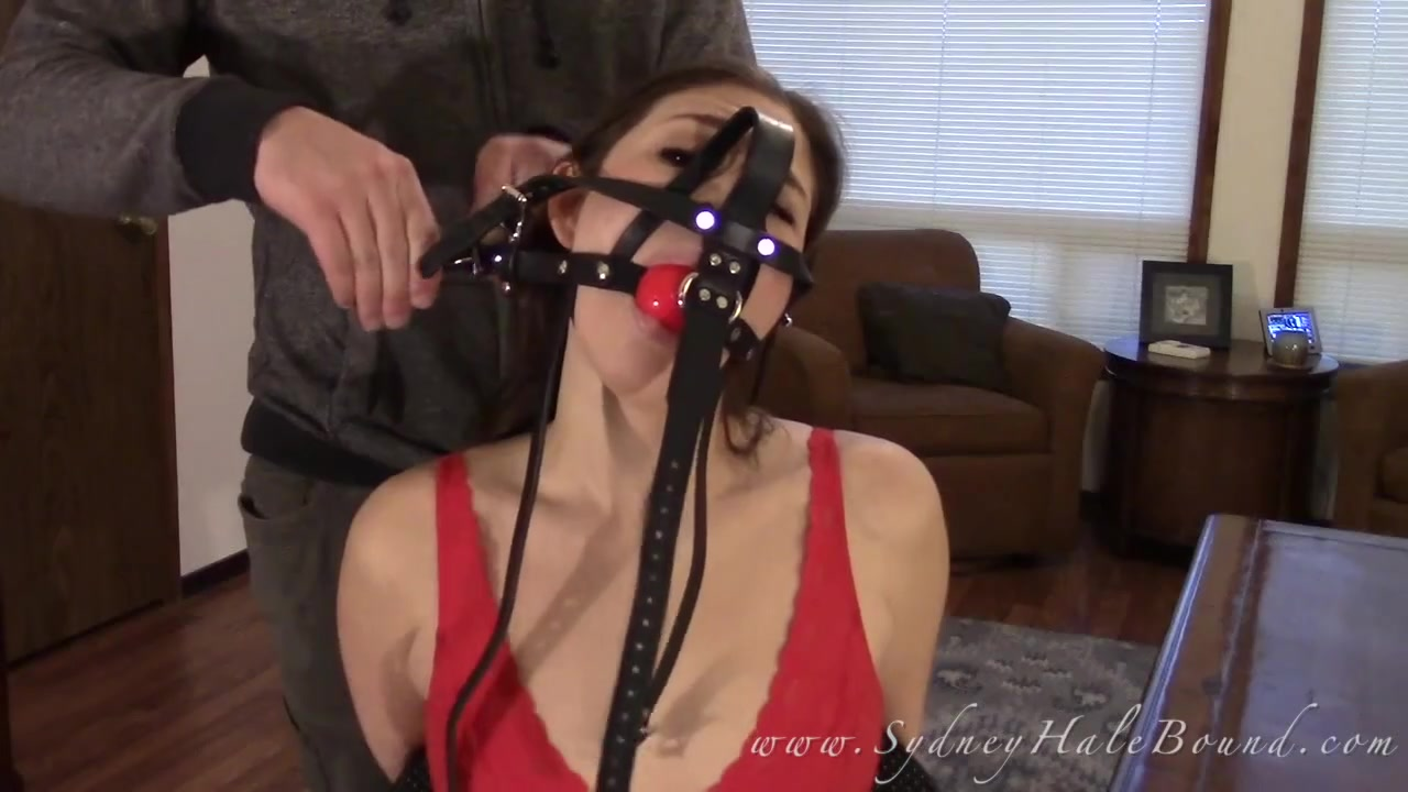Chairtied and harness gagged