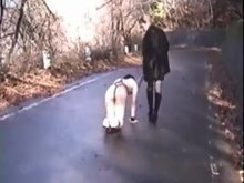 Taking her slave for a walk
