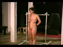 Busty young dominated with clamped boobs