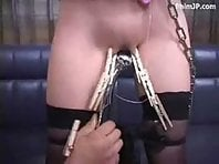 Japanese BDSM Slave in arm binder and bondage