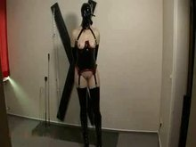 BDSM Latex - On The Cross