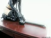 Rubber Slave Girl with Gas Mask
