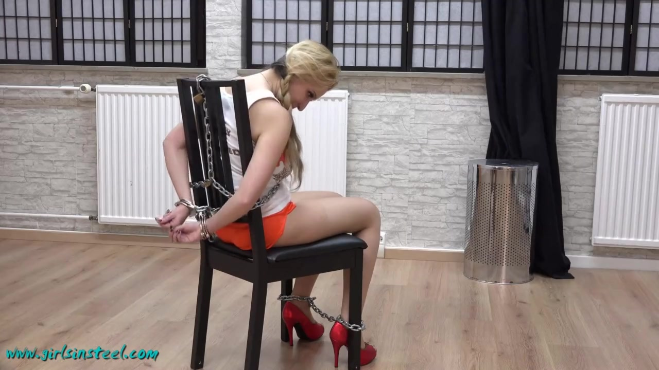 Cuffed to chair