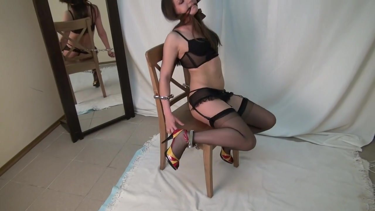 Cuffed in chair