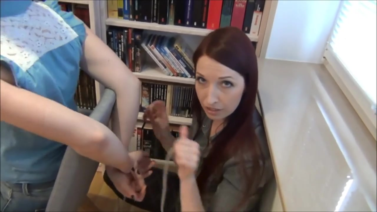Tying her girl to chair