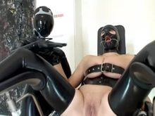 Latex Mistress and hooded sub chick