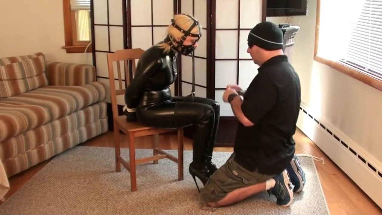 blonde Nadia in Catsuit and Boots