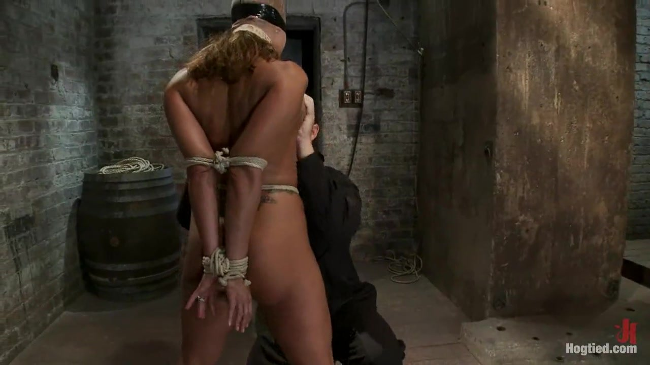 Ava Devine licks dong in bondage