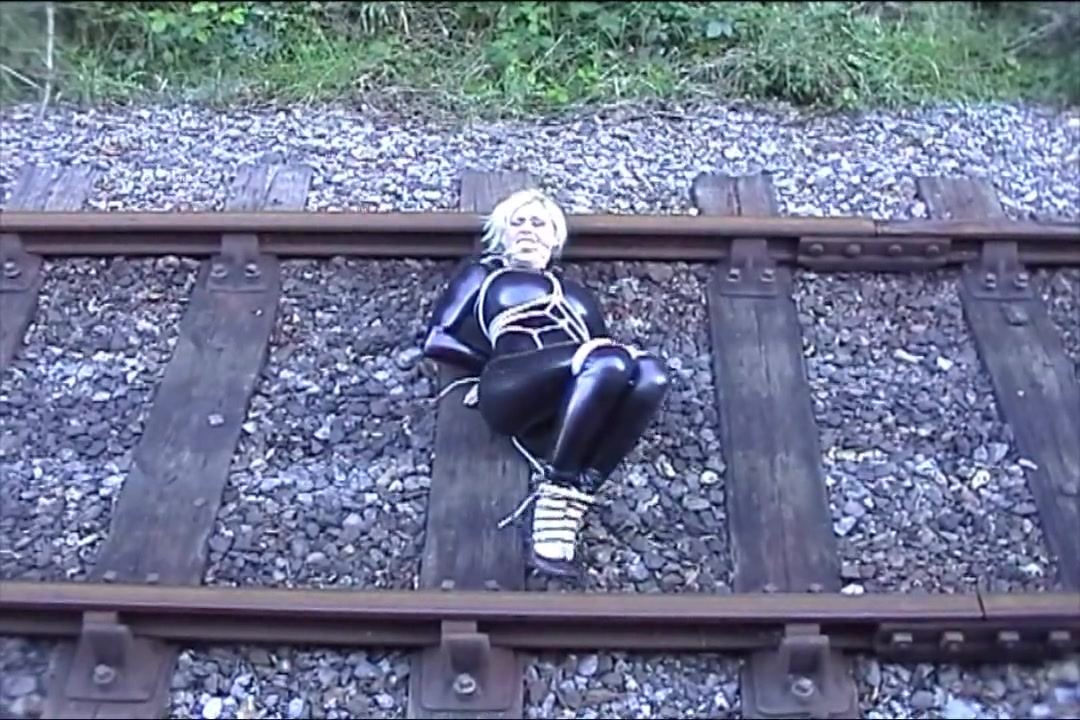 Katarina Nikita in latex on the railroad