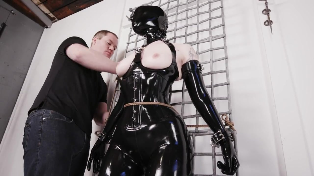 Rubber Slave and TENS BDSM