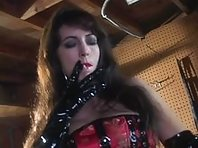 Brunette Domme in Latex with Her Bound Slave girl