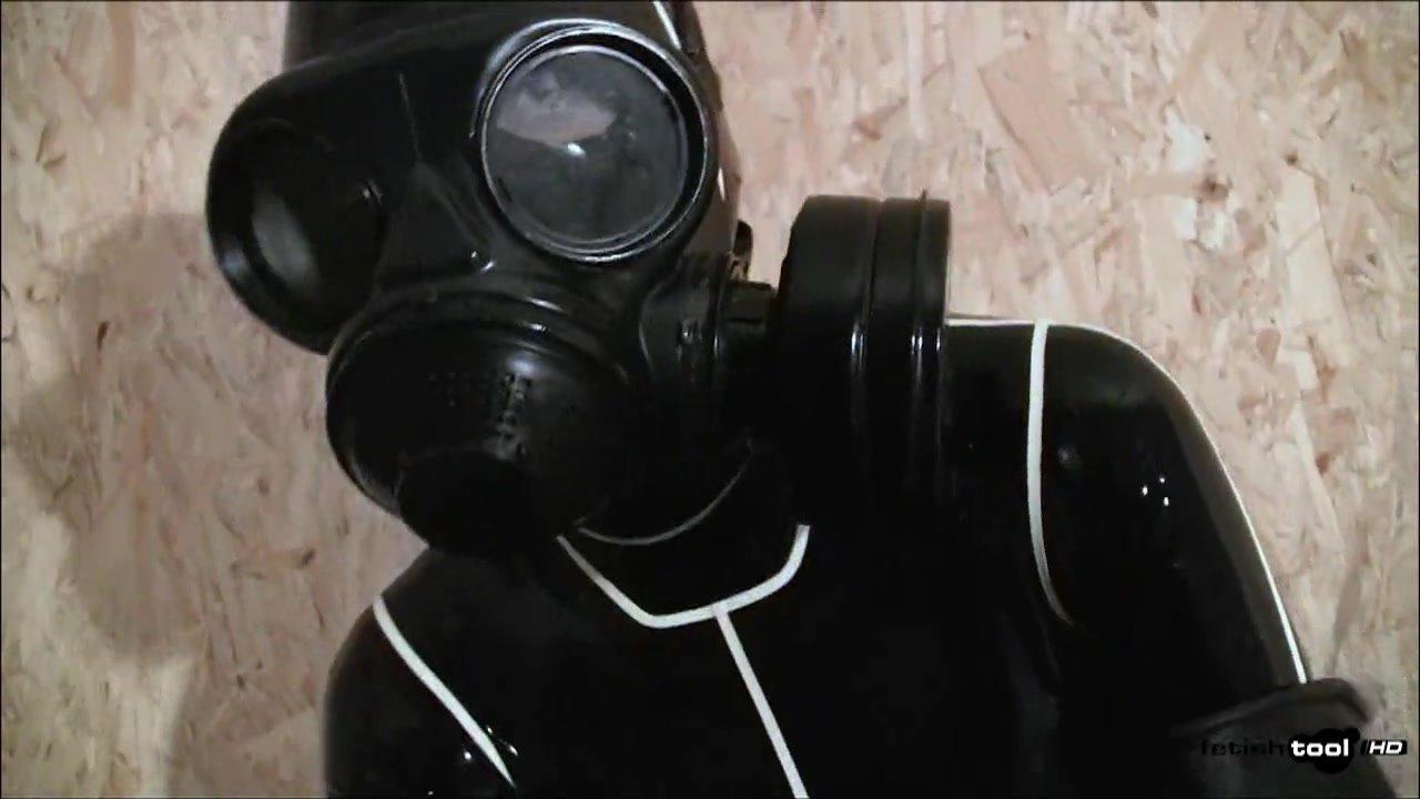 Gas Mask and Latex Catsuit