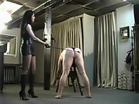 Dominatrix Punishes Ass