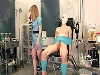 Mistress dominating her restrained male slave