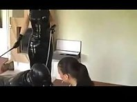 Rubber Gimp and Mistresses