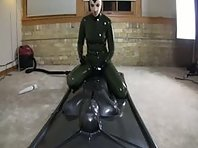 Femdom - Latexgirl using Man in Vacbed