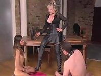 Leather Mistress with her slave girl and boy