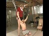 Mistress dominating slave in chains