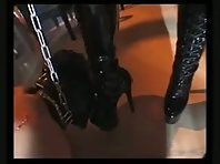 Strict Mistress with Caged Slave