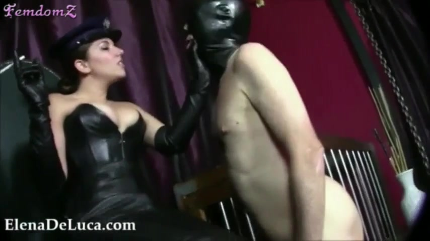 Domme Faceslaps And Flogs Naked Male