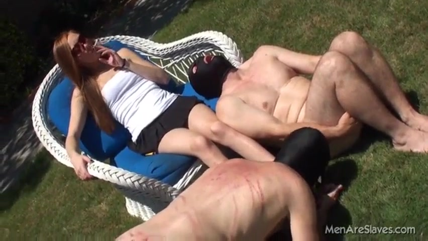 Domme Uses Whipmarked Naked Male Slaves For Outdoor Foot Worship And
