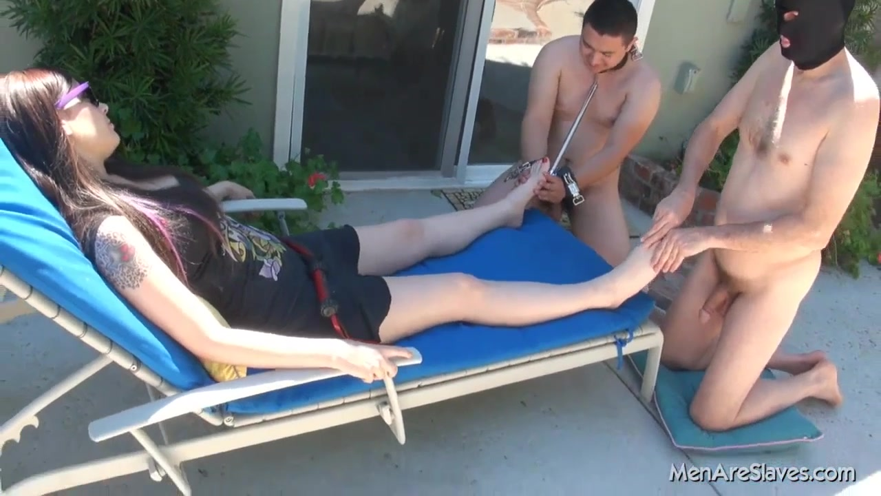 Two Kneeling And Naked Male Slaves Massage Domme Feet