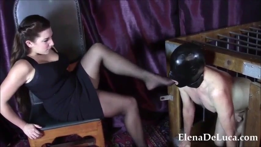 Domme Foot Fucks Mouth Of Caged And Hooded Naked Male