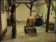 Two Russian Mistresses whipping their Slave