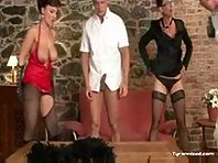 High heeled dommes dominating two submiss ...