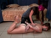 Hogtied on the floor